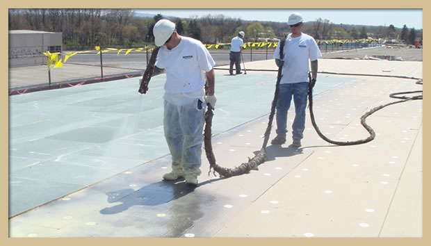 Application of spray adhesive for a EPDM fully-adhered installation